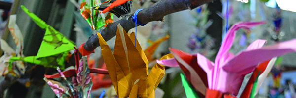 The Voices of Children Carried by a Thousand Paper Cranes Exhibit