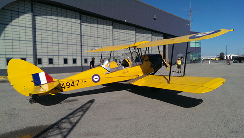 Tiger Moth aircraft parked on the tarmac