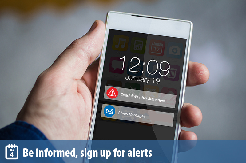 Man holding a mobile phone with alerts on the homescreen