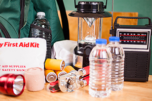 Emergency supply kit: First aid kit, batteries, flashlight, bottled water, radio, lantern