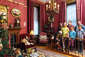 Families touring the Whitehern Historic House at Christmas