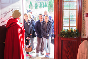 A group of students being greeted for a visit at Battlefield House Museum & Park