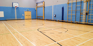 Interior image of a school basketball court/gym