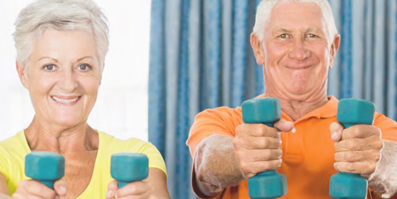 Older adults lifting weights in a gym