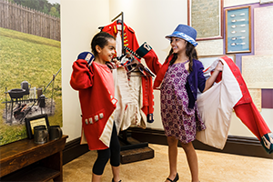 Children trying on military clothing at Military Museum