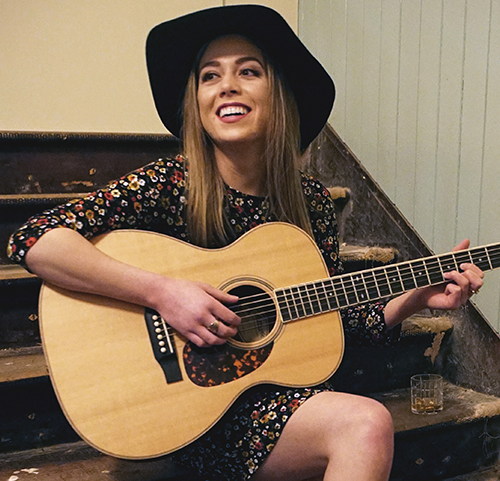 Mackenzie Leigh Meyer playing guitar
