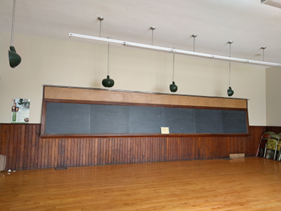 Classroom/Main Hall, approximate size: 28' x 32' includes early woodwork such as wooden doors and trim, wainscoting and set of four-over-four double hung sash windows