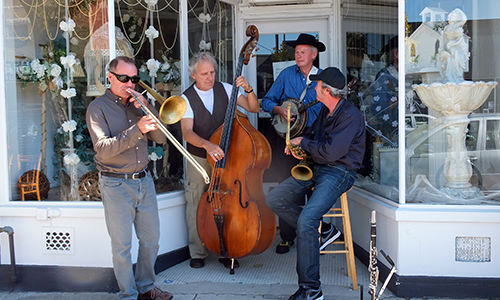 Image of musicians playing in a store front