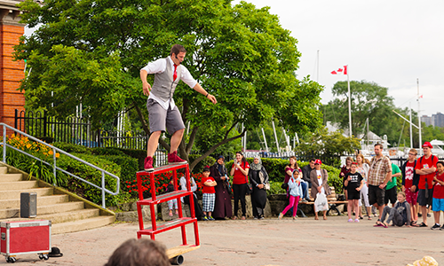 Busker performing balancing act