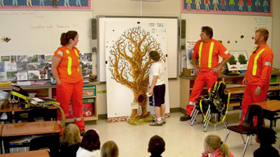 Forestry employees giving educational presentation