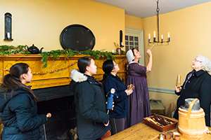 Group tour of Battlefield House Museum led by a costumed guide