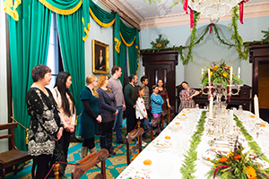 A group of people touring dining room at Dundurn Castle