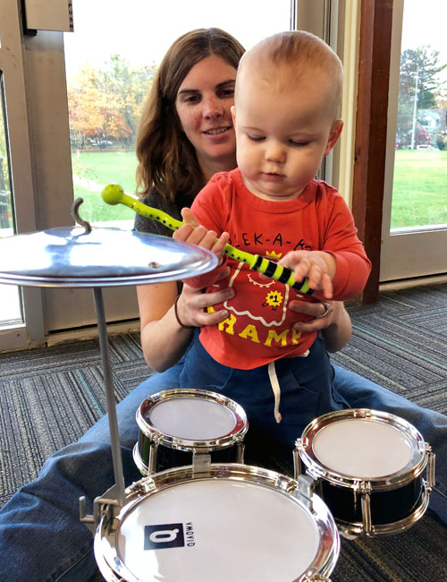 Image of Baby with it's mother and drum kit