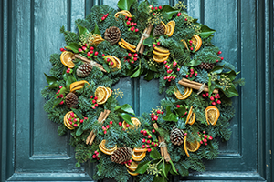 Christmas wreath on green exterior door