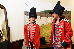 Two kids dressing up in costumes at Dundurn Castle
