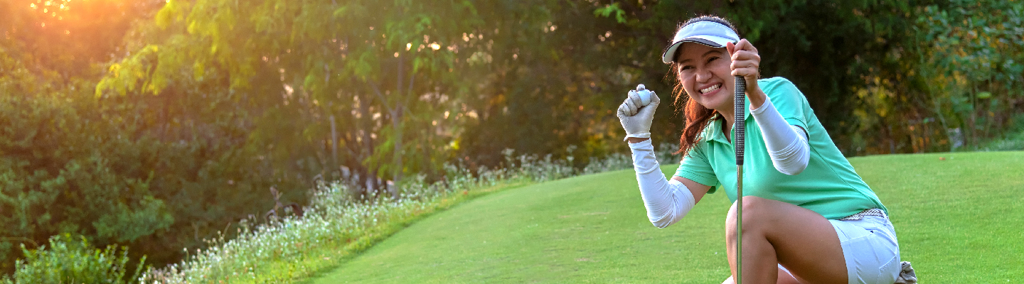 image of woman on green with golf ball