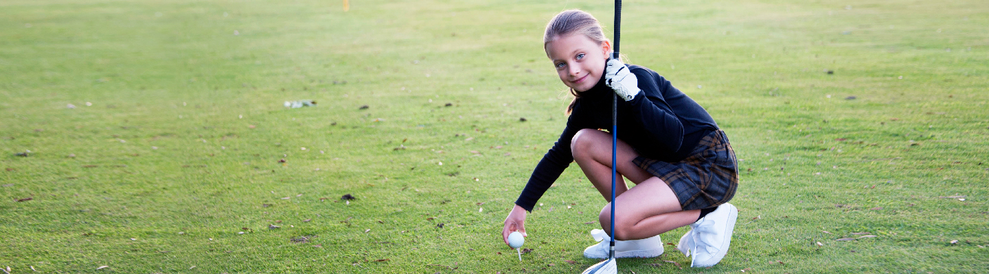 Image of youth golfer on green