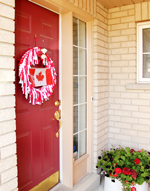 Red door decorated for Canada day