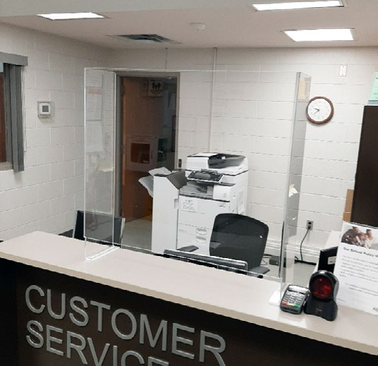 Example of shield at counter in business that does not extend to ceiling