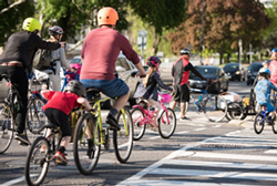 Group of parents and children riding bikes