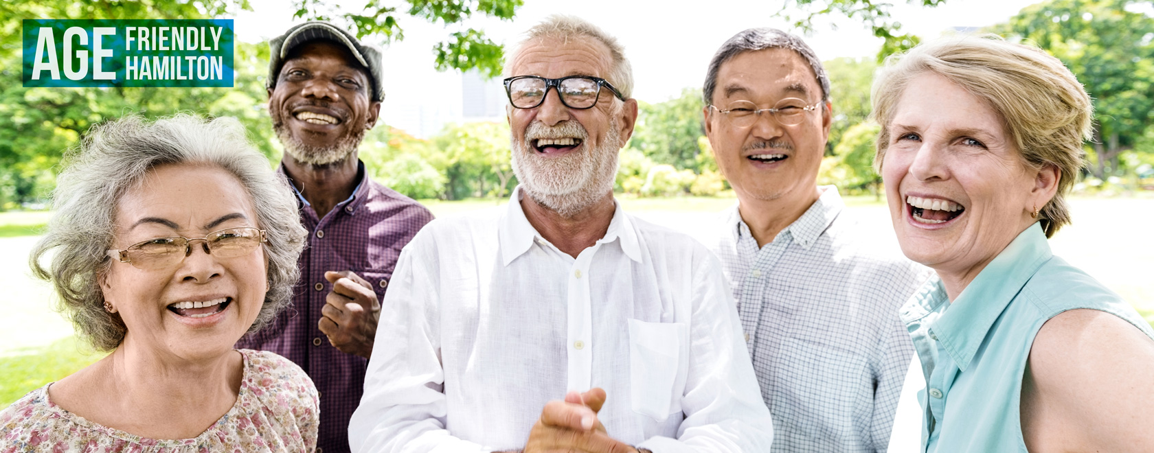 Group of older adults smiling in a park setting