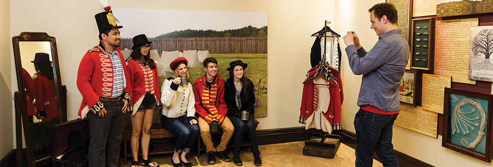 Group of adults dressed up at Military Museum